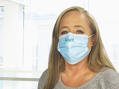 woman wearing company branded face mask